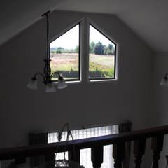 Balkon door Nomade Arquitectura y Construcción spa