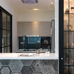 Kitchen units by 松泰室內裝修設計工程有限公司