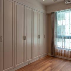 Phòng ngủ nhỏ by 松泰室內裝修設計工程有限公司