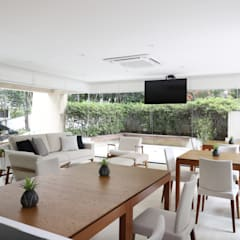 Área Gourmet e Academia de um Condominio Moderno, Contemporâneo, Clean, Sofisticado e Aconchegante: Locais de eventos  por Mirá Arquitetura,Moderno Madeira Efeito de madeira