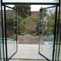 Glass extension with secure glass doors :  Walls by Ion Glass , Modern Glass