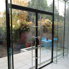 Glass extension with secure glass doors :  Walls by Ion Glass
