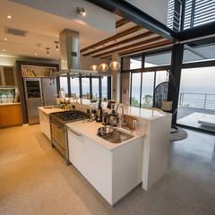 House on North Coast:  Kitchen by John Smillie Architects