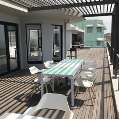 Ocean Vista Guest House:  Patios by John Smillie Architects