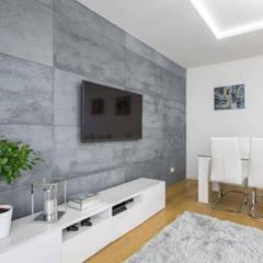 Beton architektoniczny w salonie: styl , w kategorii Ściany zaprojektowany przez Luxum