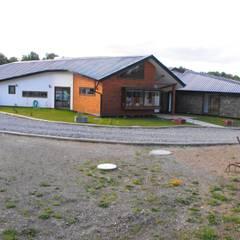 Vivienda B C: Casas unifamiliares de estilo  por Nomade Arquitectura y Construcción spa
