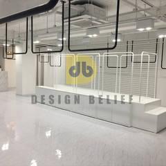 압구정 명품편집샵: (주)디비디자인의  상업 공간