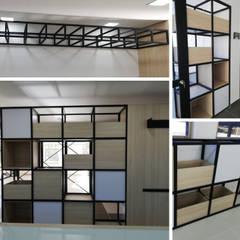 Biblioteca Vermont School Medellín: Estudios y despachos de estilo  por Decó ambientes a la medida