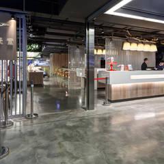 饗食天堂台南店:  餐廳 by 伊歐室內裝修設計有限公司