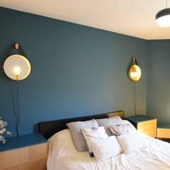 Rénovation complète d'un 2 pièces: Chambre de style  par Atelier BOA