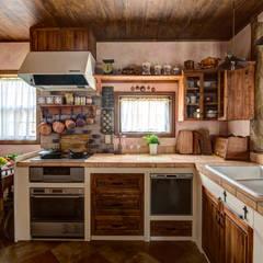 暮らしに楽しさが舞い込む住まい〜Y様邸〜: 有限会社グリーンアンドハウスが手掛けたキッチンです。,クラシック