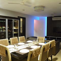 Full Home Interior Lonavala:  Dining room by ECLECTIC INTERIORS AND SERVICES
