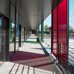 Centre commercial Prat Pip à Guipavas: Centres commerciaux de style  par Trace & Associes architecture