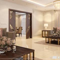 فيلا خاصة:  غرفة المعيشة تنفيذ Vogue Design, كلاسيكي