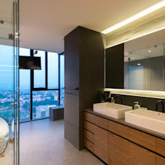 : Baños de estilo  por Concepto Taller de Arquitectura