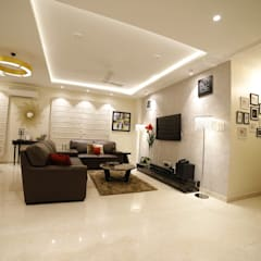 Salas / recibidores de estilo  por Rashi Agarwal Designs