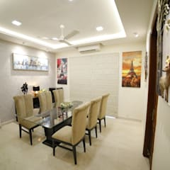 Dining:  Dining room by Rashi Agarwal Designs