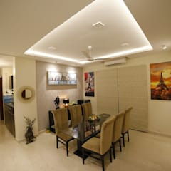 DINING AREA:  Dining room by Rashi Agarwal Designs