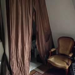Studio Paris 17: Salon de style  par Casamo