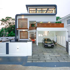 :  Detached home by Monnaie Architects & Interiors