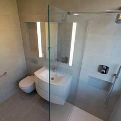 EALING LOFT CONVERSION:  Bathroom by The Market Design & Build, Modern