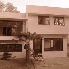 Construcción de Casa Chacon el La Reina, Region Metropolitana, Santiago: Casas unifamiliares de estilo  por RCR Arquitectos,