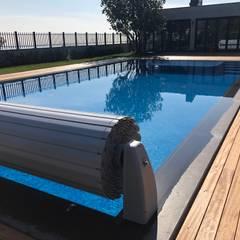Pool Office Havuzculuk – İhlas Marmara Evlerinde Havuz & Havuz Güvenlik Panjuru:  tarz Bahçe havuzu