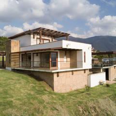 Terrace by cesar sierra daza Arquitecto, Rustic Stone