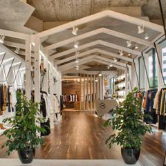MUONTI DRESS CODE: Espaços comerciais  por Imagem Publica, Design & Comunicação