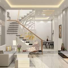 Nhà phố 1 trệt 2 lầu đẹp:  Phòng khách by Công ty xây dựng nhà đẹp mới, Hiện đại