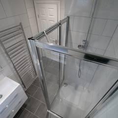 Watford Loft Conversion:  Bathroom by The Market Design & Build