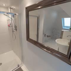 TWICKENHAM LOFT CONVERSION:  Bathroom by The Market Design & Build