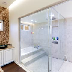 아름다운 곡선 디자인이 특징인 지중해풍 고급 주택 (전라남도 순천시): 더존하우징의  욕실