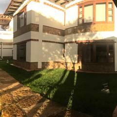 cesar sierra daza Arquitecto의  다가구 주택
