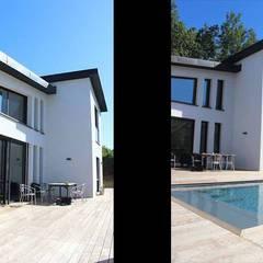Maison contemporaine à toit zinc: Maison individuelle de style  par Atelier SCENARIO