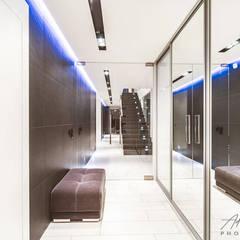 Realizacja salonu w domu jednorodzinnym w Rudzie Śląskiej: styl , w kategorii Korytarz, przedpokój zaprojektowany przez Archi group Adam Kuropatwa