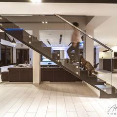 Realizacja salonu w domu jednorodzinnym w Rudzie Śląskiej: styl , w kategorii Schody zaprojektowany przez Archi group Adam Kuropatwa,