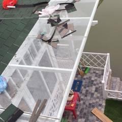 Lean-to roof by Công ty TNHH Xây dựng và Thương mại Việt Pháp, Modern