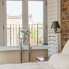 Loft Conversion – Clapham:  Small bedroom by Armstrong Simmonds Architects