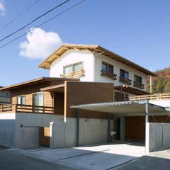 Casas unifamiliares de estilo  por 株式会社田渕建築設計事務所