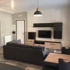 Salas / recibidores de estilo  por Omnia Multiservizi - Roma Invest