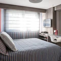 Apartamento decorado: Quartos  por Anne Báril Arquitetura