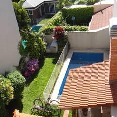 Jardin con Quincho y Pileta de Natacion: Quinchos de estilo  por GR Arquitectura