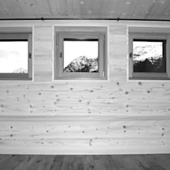 Phòng ngủ nhỏ by quartier b architekten gmbh