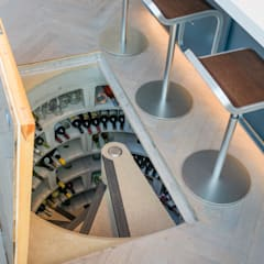 Spiral Cellars with Concealed Doors :  Wine cellar by Spiral Cellars, Rustic