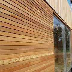 Timber cladding London:  Houses by Benchmark Timber LTD
