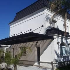 cochera barrios Los alisos NorDElta: Garajes de estilo  por sinnic,Moderno Hierro/Acero