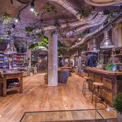 Metropolitan Jungle: Negozi & Locali commerciali in stile  di  ILAB2.0 Design Studio