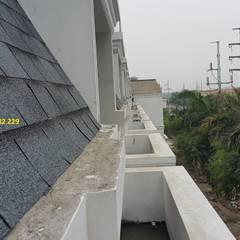 Ngói bitum phủ đá:  Khu Thương mại by Công ty TNHH Xây dựng và Thương mại Việt Pháp