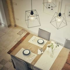 Dining room by  ILAB2.0 Design Studio